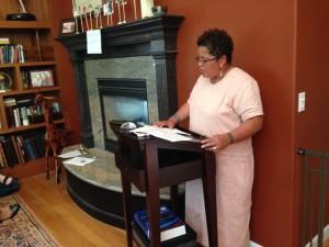 Faith Adiele reading in the home of Susan Ito.